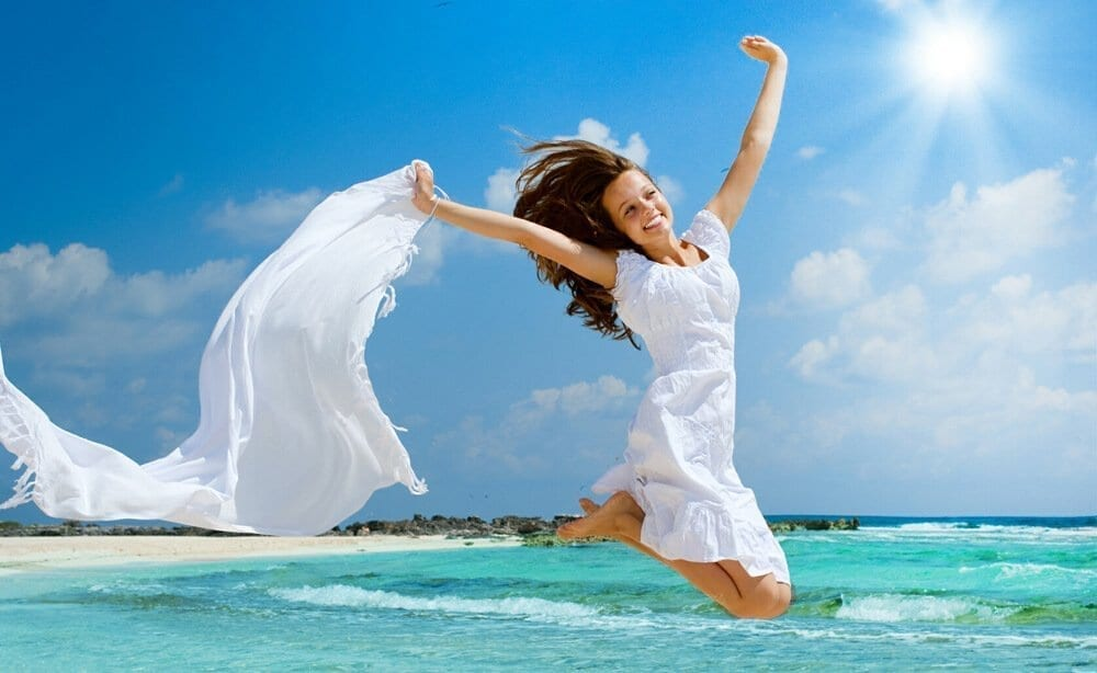 Girl With White Scarf Jumping on The Beach
