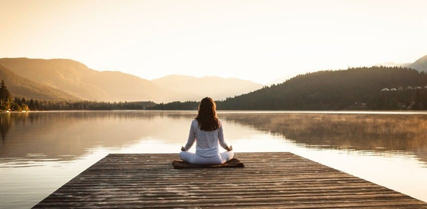 meditation in front of a lake