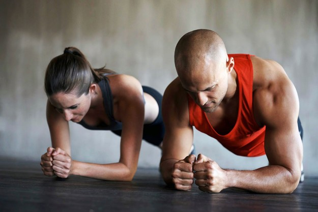 man and woman in a high plank position