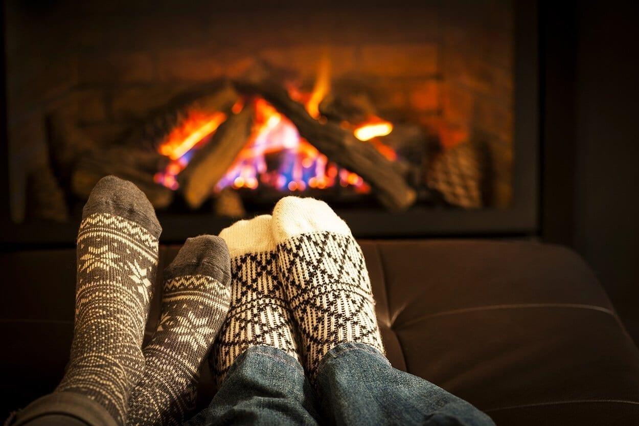 feet warming by fireplace