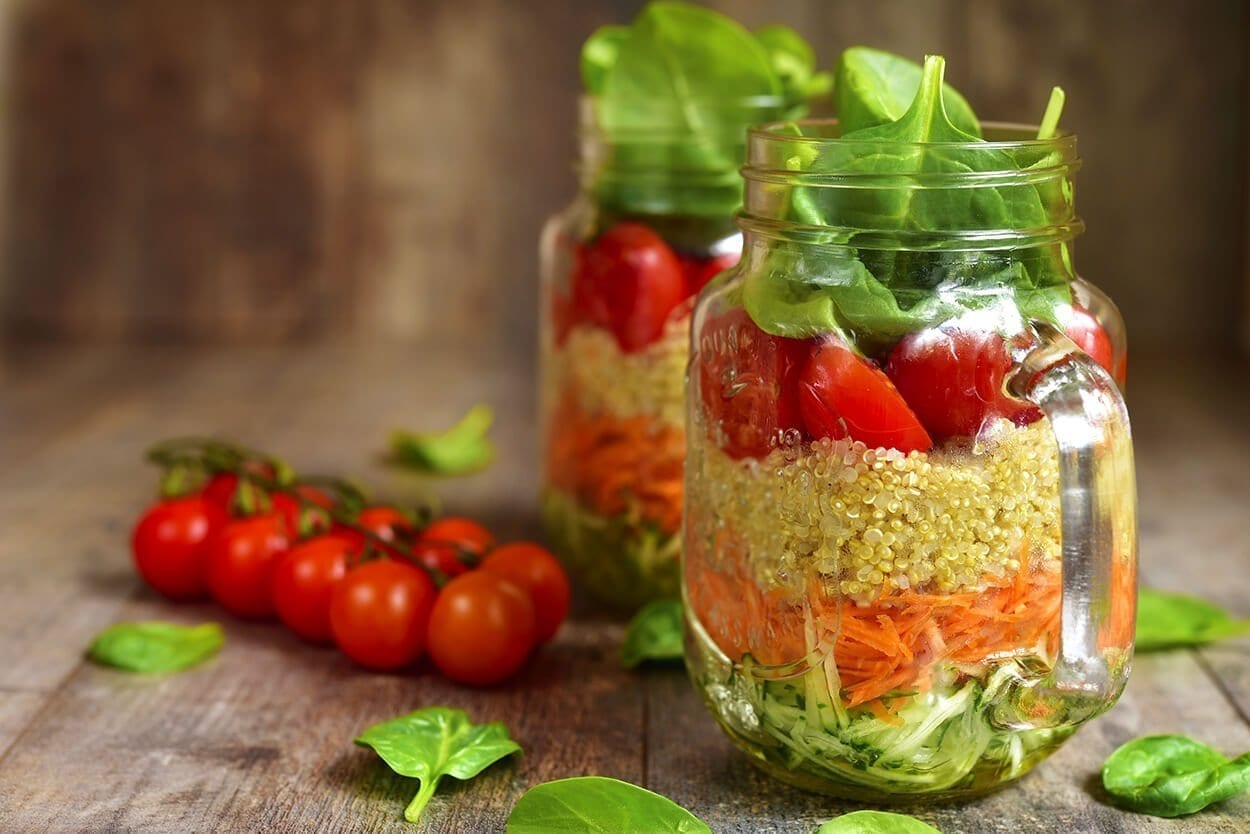 salad with quinoa and vegetables in a mason jar