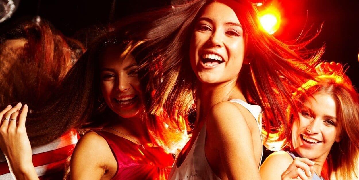 three happy dancing women