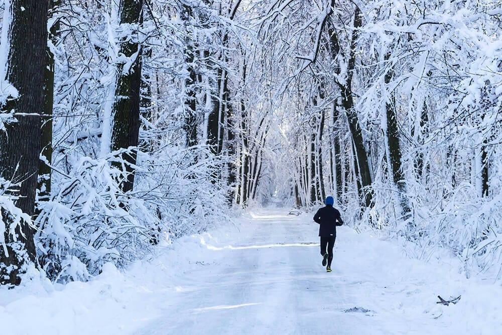running in snowy woods