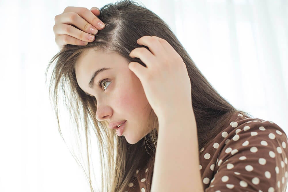 lady examining her hair line