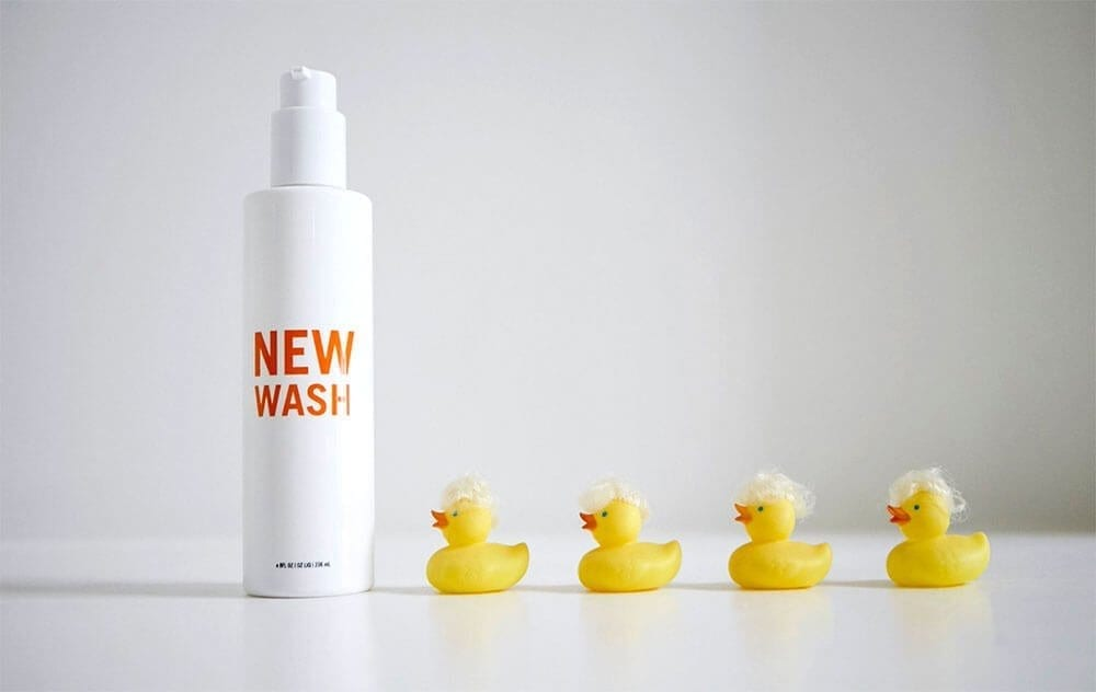 new wash spray bottle next to rubber ducks