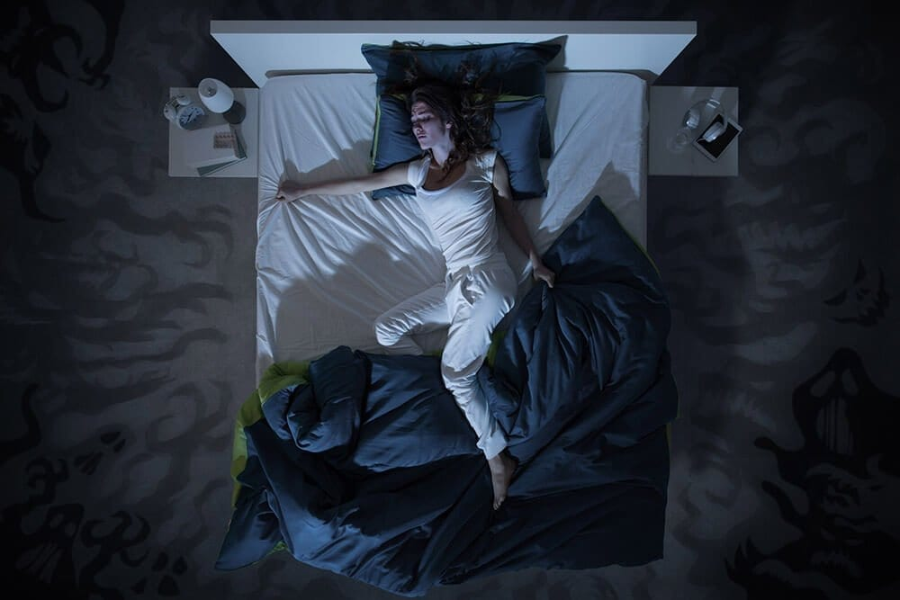 lady sleeping on a double bed