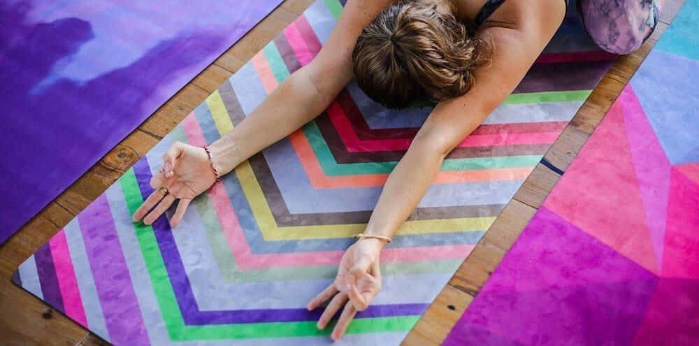 woman doing yoga on a yoga mat