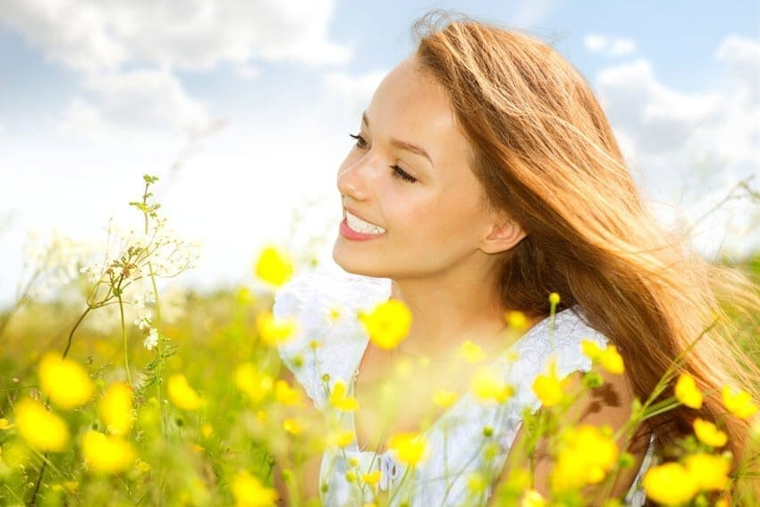 lady smiling in a rapeseed field