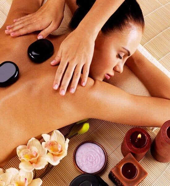 woman getting a black stone massage